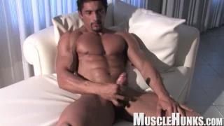 Gay muscley hunk stud plays with his big cock
