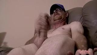 rough-looking guy jacking his hard dick