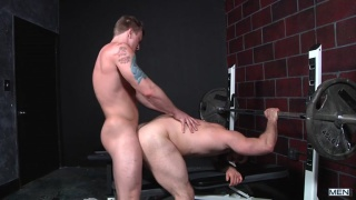 blond takes hunk's virgin ass in the gym