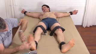 muscular hunk gets bare feet tickled
