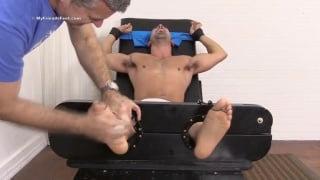 masculine hunk Kal strapped in and tickled