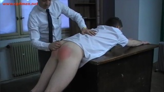 school master spanks boy's bare ass