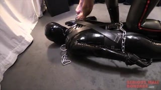 sub slips into a rubber body suit