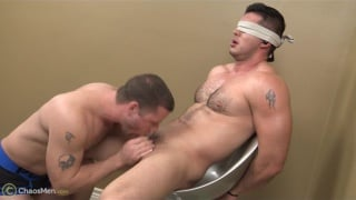 blindfolded hunk tied to a chair and blown