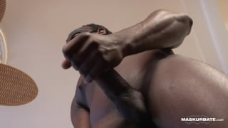 masked black hunk masturbates