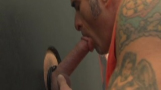 inked cocksucker giving glory hole head