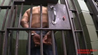handcuffed prisoner put in jail cell