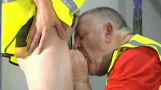 construction daddy giving head to young guy