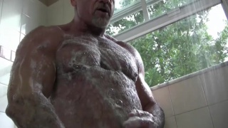 beefy hunk soaps up in shower