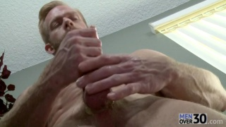 blond hunk Christopher Daniels stroking off