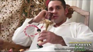 Hamad enjoys his hookah watching his friends suck
