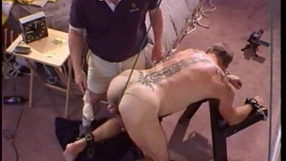 slave goes over sawhorse for some fun