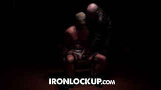 sub strapped to a chair  gets a beating