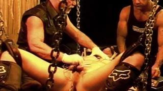 leather sling bottom in CBT scene
