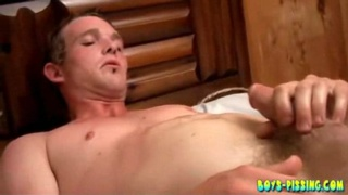Twink pisses on himself and jerks