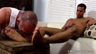 dark-skinned guy gets his feet completely adored