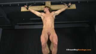 Blond muscle stud roped to a cross