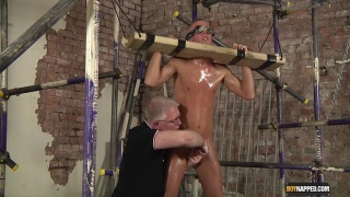 guy in stockade gets his nuts drained