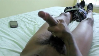 black dude in tuque jacks his long cock