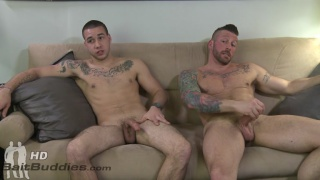 gay and straight inked guys on the couch