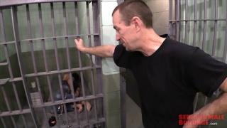prison guard taunts prisoner in cell