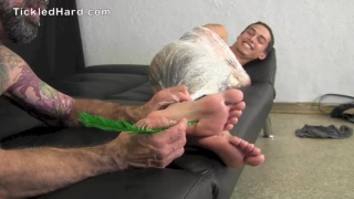 guy mummified in plastic gets bare feet tickled