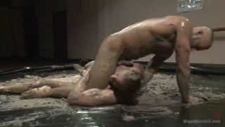 Jessie Colter and Jimmy Bullet wrestling naked in mud