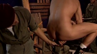 couple of soldiers have fun with a dildo