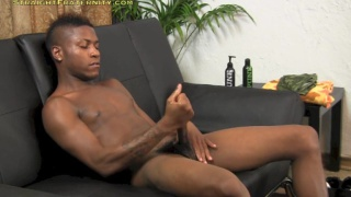 skinny black dude strokes his long cock