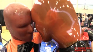 men in rubber playing around