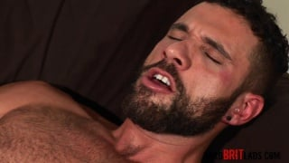 sexy bearded hunk stroking his big cock
