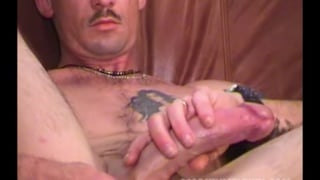 inked dude blows cum on his furry belly