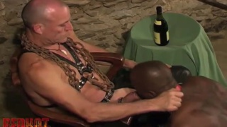 muscle daddy plays with a large black cock