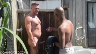 Hans Berlin and James Key in outdoor shower