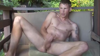 marine with fat cock stroking in the jungle