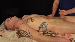 masseur gives sexy guy handjob