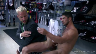 suited executive sits on russian hunk's cock