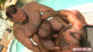 big bear riding tattooed top's cock outdoors
