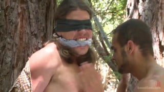 bald daddy torments long-haired dude in the woods