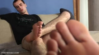 ben plays with his dirty socked feet