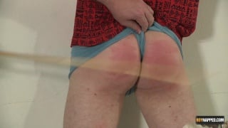 poor olly's ass is caned bright red