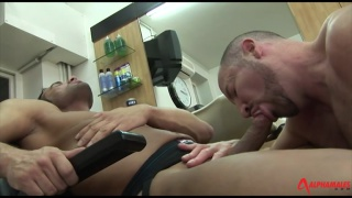 daddy blows a hung in a barbershop chair