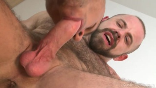 spanish hunk plays with furry man's huge cock