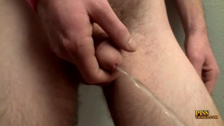 curious dude pisses and jacks his dick