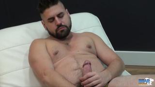 handsome bear strokes his fat cock