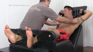 Hunky Derrick gets his big bare feet Tickled
