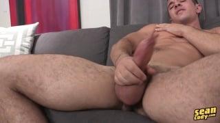 hunky evan stroking his big dick