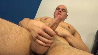 bald muscle hunk jacks off in gym