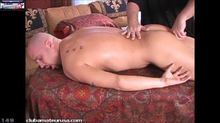 beefy bald hunk gets serviced on massage table