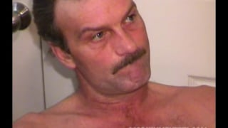 sexy man with mustache jerks off